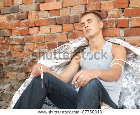 smoking drug addict young man in action, outdoor
