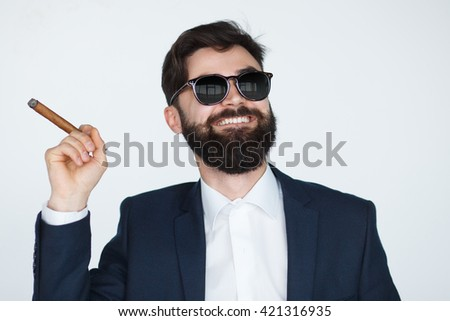 smoking elegant bearded man isolated on white background. Handsome successful man smiling with cigar.