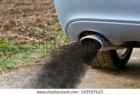Smoking exhaust pipe  - stock photo