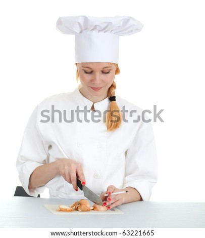 smoking female cook in white uniform and hat cutting onion - stock photo