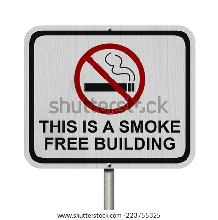 Smoking Free Building Sign, An red road sign with cigarette icon and not symbol with text isolated on white - stock photo