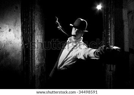 smoking gangster with pistol - stock photo