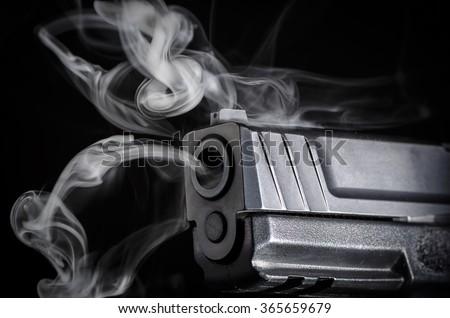 Smoking Gun - Crime Evidence Concept  - stock photo