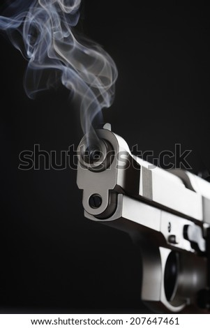 Smoking Handgun - stock photo