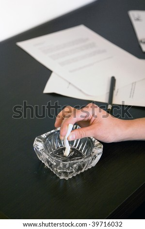 Smoking has been banned in the workplace in the UK and many other countries - stock photo