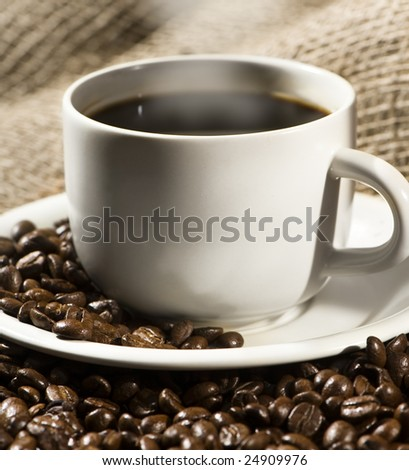 smoking hot cup of coffee. Partial. - stock photo