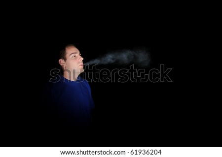 Smoking in the night time darkness. - stock photo