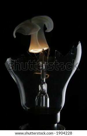 Smoking lightbulb - stock photo