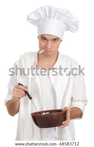 smoking male cook in white uniform and hat with brown bowl - stock photo