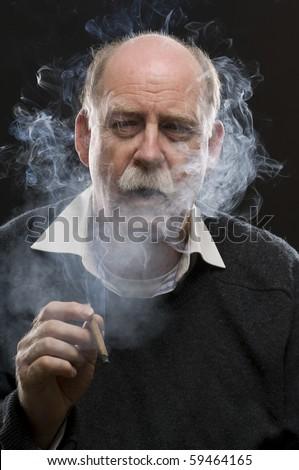 Smoking man - stock photo