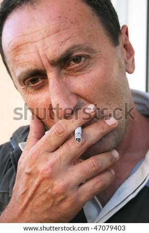 Smoking man, closeup picture. - stock photo