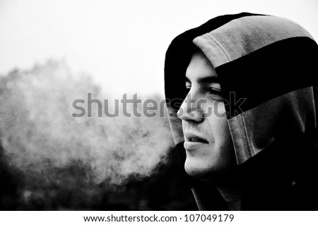 Smoking man in black an white - stock photo