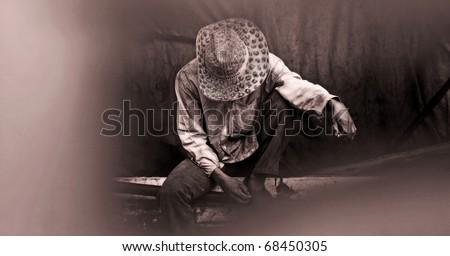 smoking man sitting on bench in Bangkok Thailand, abstract - stock photo