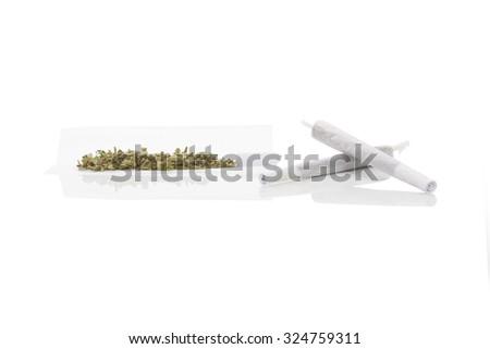 Smoking marijuana. Cannabis abuse. Marijuana bud, hashish, and rolled joint isolated on white background.  - stock photo
