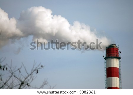 smoking pipe of factory contaminating an environment - stock photo