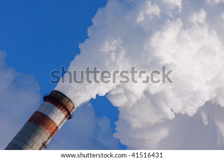smoking pipe of factory, contaminating an environment on a background clean sky - stock photo
