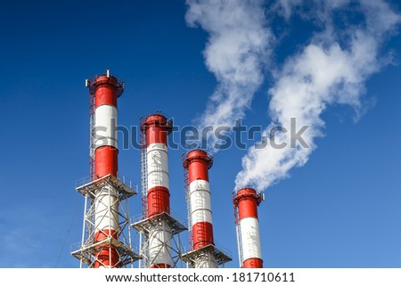 Smoking pipes of a thermal power plant - stock photo
