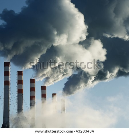 Smoking plant and blue sky - stock photo