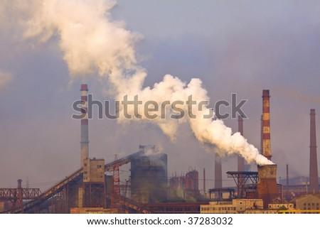 Smoking plant with white smog. environment concept - stock photo