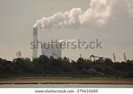 Smoking power plant - stock photo