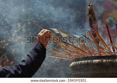 Smoking prayer sticks at vietnamese pagoda - stock photo