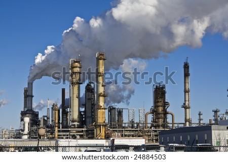 Smoking Refinery in Illinois, USA. - stock photo