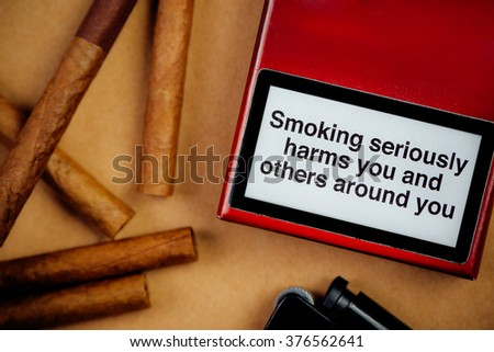 Smoking seriously harms you and others around you generic message on a pack of cigarettes. - stock photo