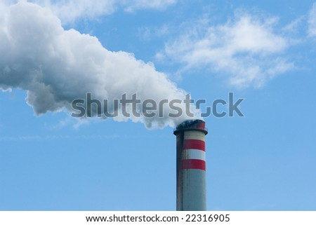 smoking smokestack with blue sky
