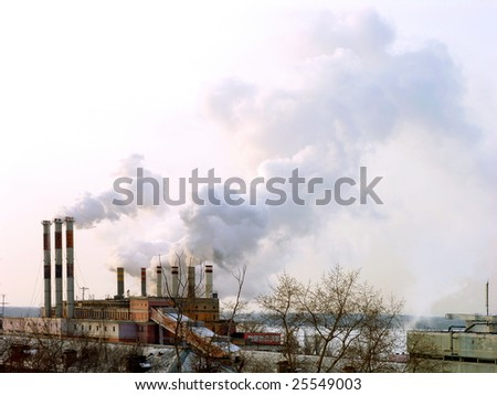 Smoking stacks of thermal power station - stock photo