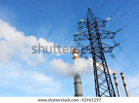 Smoking stacks of thermal power station and power line - stock photo