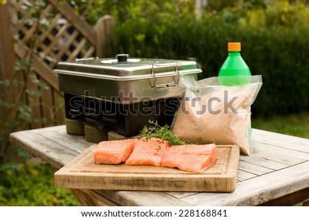 Smoking the fish - stock photo