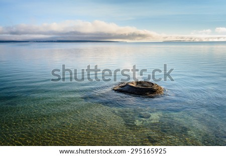 Smoking Thermal Feature in Lake at Yellow Stone National Park - stock photo