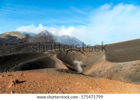 Smoking triple tip of the Etna, Sicily with small crater - stock photo