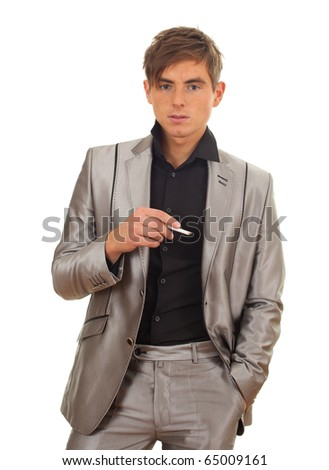 smoking young handsome man in grey suit - stock photo