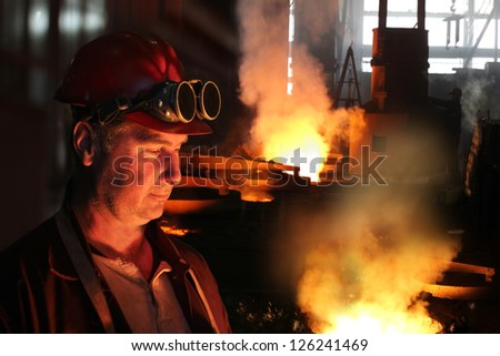 Smoky and Hard working in a Foundry - stock photo
