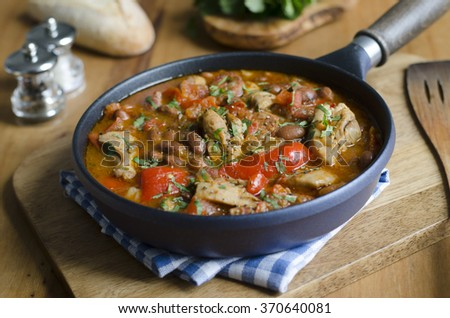 Smoky chicken and bean stew in a pan - stock photo