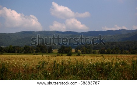 Smoky Mountains Cades cove valley, with rows of mountains in background - stock photo