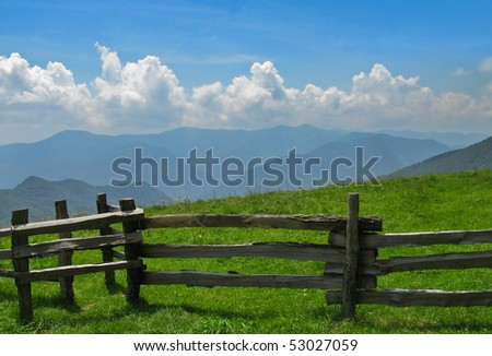 Smoky Mountains with fence in foreground. - stock photo