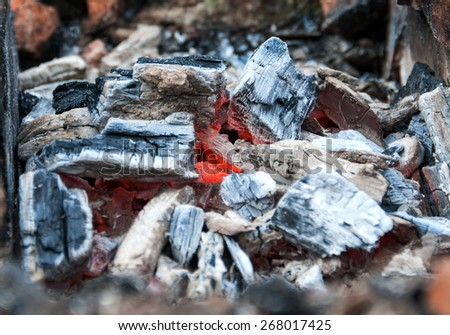 smoldering coal closeup - stock photo