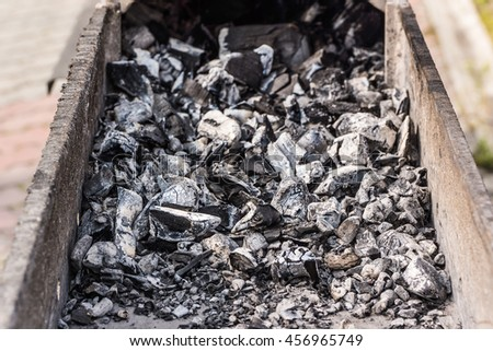 Smoldering hot coals in the grill or tandoor for cooking meat barbecue. BBQ on sweem the air. - stock photo