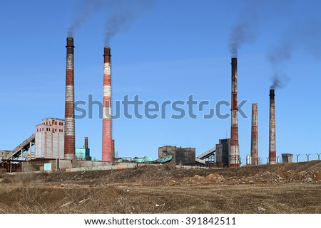 Smoldering pipe working plant pollute the atmosphere of the earth. - stock photo