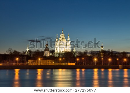 Smolny Cathedral on the Neva river at the summer night, St. Petersburg, Russia - stock photo