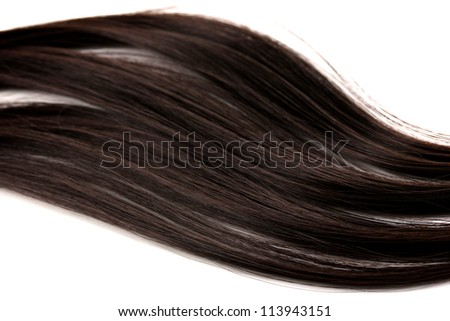 Smooth brown hair close-up isolated on white