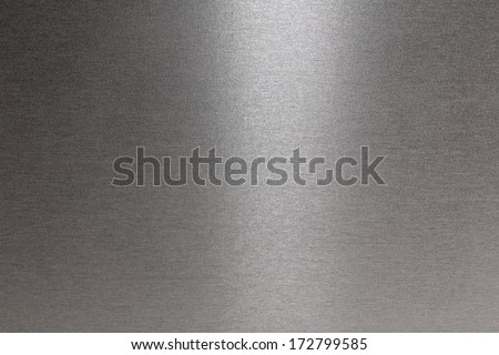 Smooth brushed metallic texture as a background - stock photo