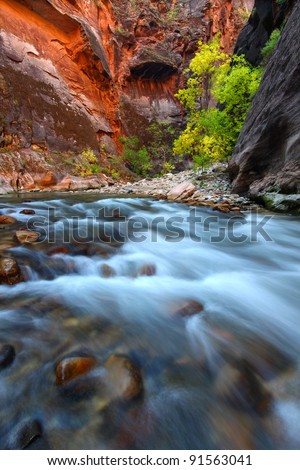 Smooth cascades of the Virgin River flow through The Narrows of Zion Canyon in Utah - stock photo