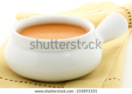 Smooth, creamy and  highly-seasoned french lobster bisque, this delicious cream soup of french origin is a classic, and can be made from lobster, crab, shrimp or crayfish. - stock photo