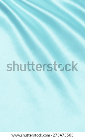 Smooth elegant blue silk or satin can use as background
