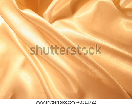 Smooth elegant gold silk can use as background - stock photo