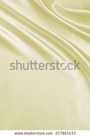 Smooth elegant golden silk can use as wedding background - stock photo
