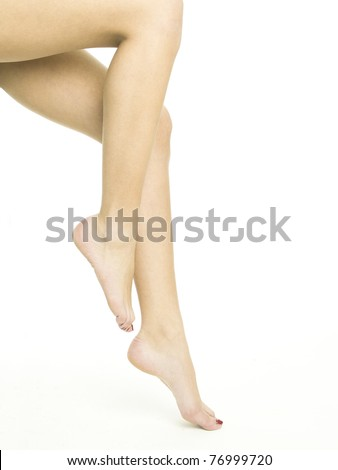 Smooth female legs on a white background - stock photo